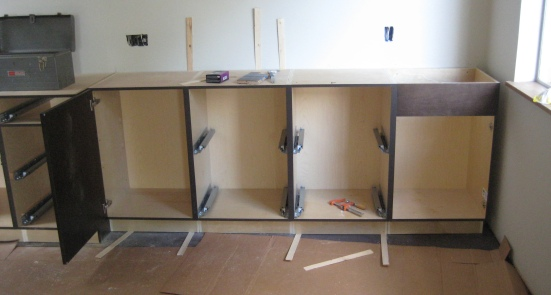 Cabinetry being installed